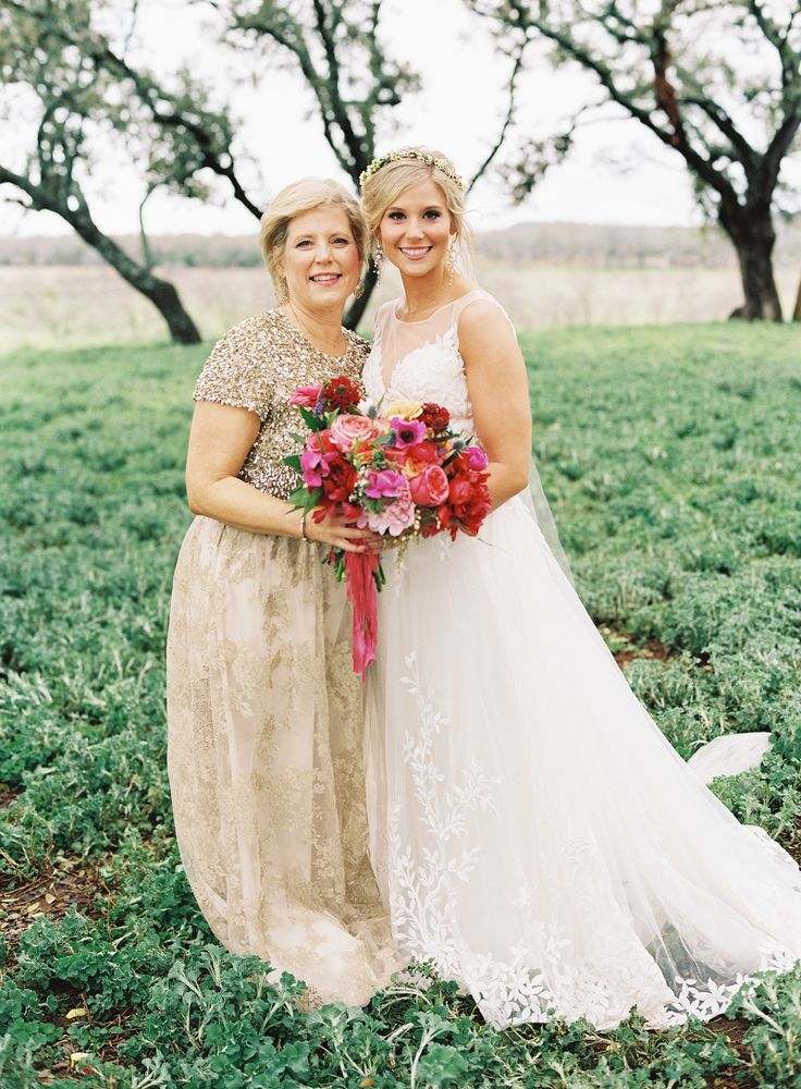 mother of the bride in gold dress Photography: Brett Heidebrecht - www.brettheidebrecht.com  Read More: http://www.stylemepretty.com/2015/06/02/colorful-boho-glam-texas-hill-country-wedding/