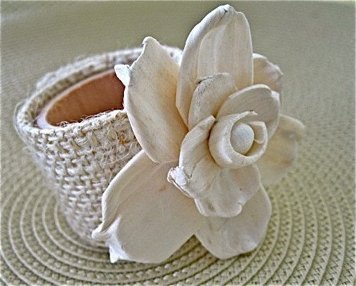 Set of four Sola Flower Napkin Rings. Add texture and simple elegance to your table top with these beautiful sola flower napkin rings.   Sola flowers are handmade flowers from Tapioca Wood. It is a soft wood, giving it a delicate look, but durable enough for your table top. Please remember to handle with some care.  Each napkin ring has a wooden (unfinished, but sanded) core with a creamy colored burlap securely wrapped around it. The Sola Flower is placed on top.