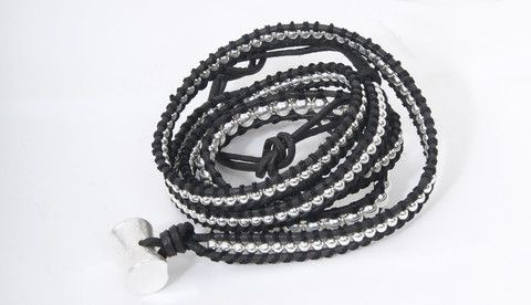 A handmade trendy bracelet which is made of leather and 100% silver, that can be wrapped around the wrist up to 3 times.