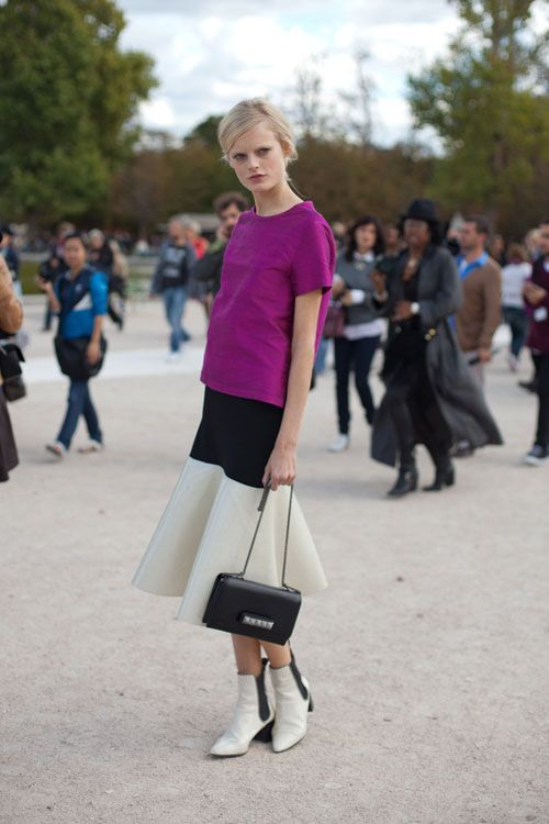 STREET STYLE SPRING 2013: PARIS FASHION WEEK - Hanne Gaby melds elegant and edgy with rocker boots and a Valentino bag.