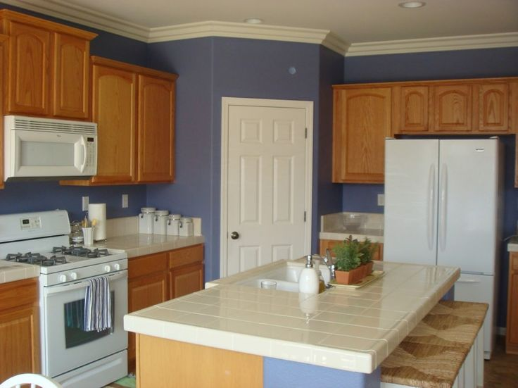 16 best kitchen images on pinterest backsplash ideas for Kitchen wall colors with honey oak cabinets
