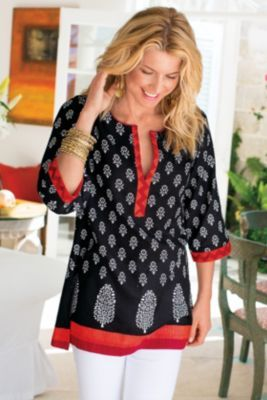 "Block Print Tunic from Soft Surroundingstem #25447 $69.95 Folkloric cotton tunic features traditional block-printed motifs against subtle shadow stripes, artfully embellished with a lively red and coral zigzag border at the partial placket and three-quarter length sleeves. Red piping edges the split jewel neckline. Side slits. Misses 32-1/2"" long."