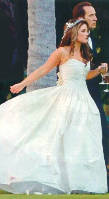 Lisa Marie Presley wed Nicholas Cage in Hawaii in 2002. She wore a simple strapless, silk taffeta wedding gown by Badgley Mischka.