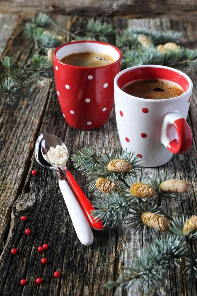 Christmas mood, two cups of coffee and pine branches on old wooden surface
