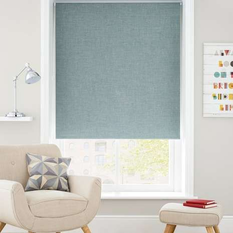 Reduce unwanted sunlight from entering your room with this blackout roller blind, featuring a woven texture in tranquil teal tones to complement a modern décor.