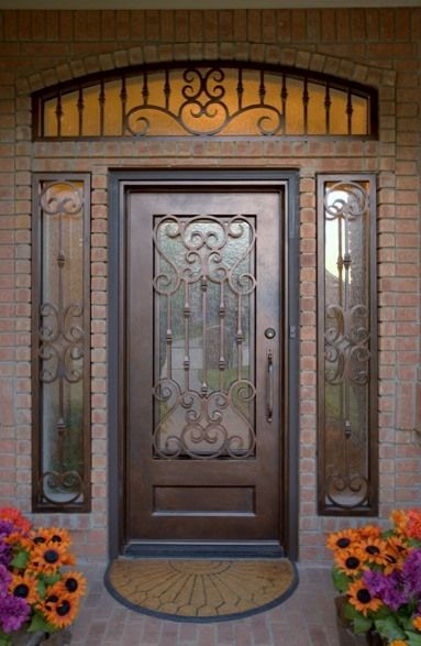 Custom wrought iron door with sidelight and transom grills.  aaleadedglass.com