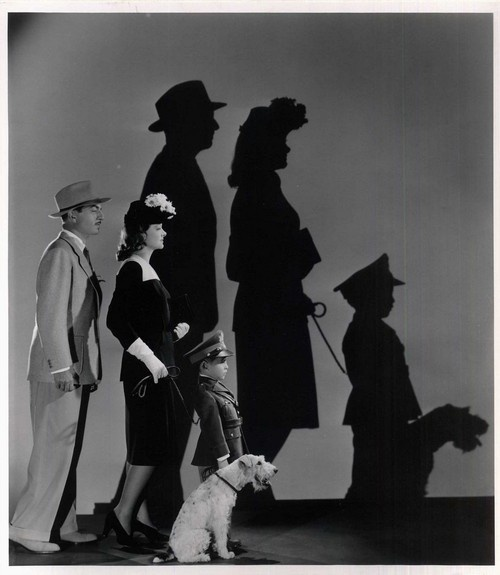 """William Powell and Myrna Loy as Nick and Nora Charles with their son Nick Jr and their loyal dog Asta in """"The Thin Man"""" movie series"""