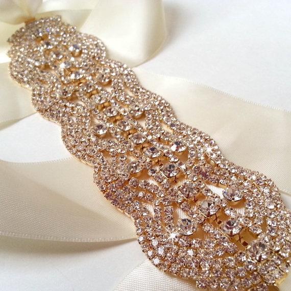 Gold Wedding Dress Sash, Rhinestone Encrusted Bridal Belt Sash - Custom Champagne, Ivory, White Satin Ribbon - Crystal Wide Wedding Belt. $60.00, via Etsy.