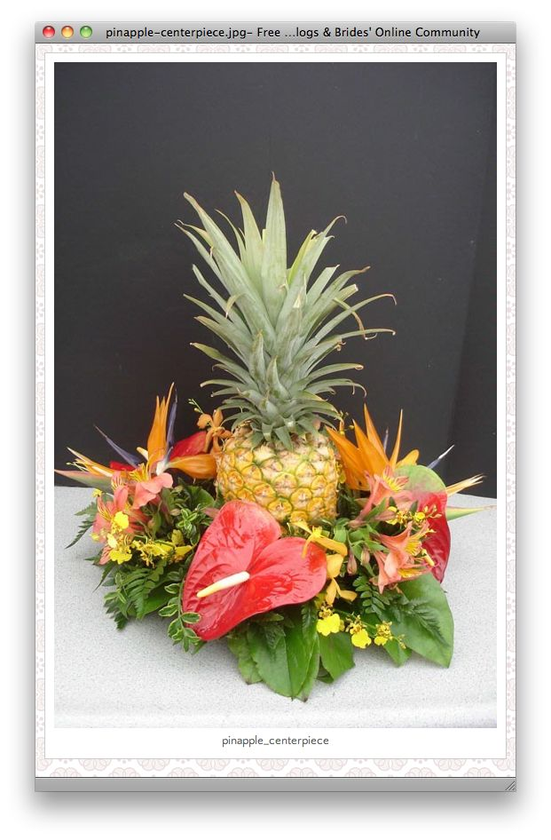 Pineapple Centerpiece With Anthuriums And Birds Of