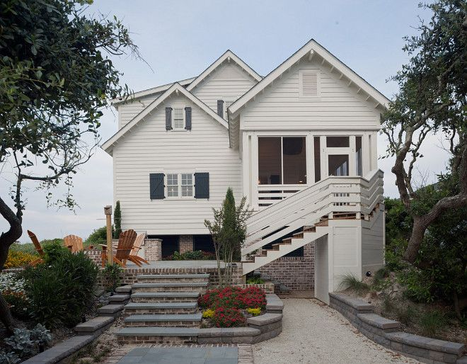 White beach house exterior. paragon-custom-construction-llc