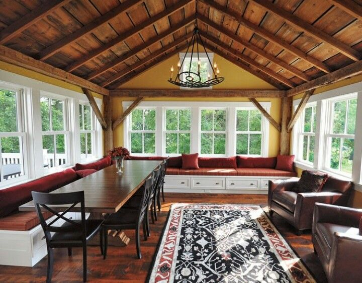 Four Season Room with Exposed Ceiling. Love the built in seating. B&B dinning area