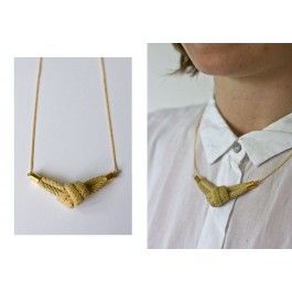 This necklace is designed by rokita.rokita is one part of the art collective THINGS LIKE DIAMONDS.Light brown cotton knot on a 45 cm brass chain/cotton string.Due to the handmade nature of each article and online screen colors - size, shape and color may vary slightly to what you see here.