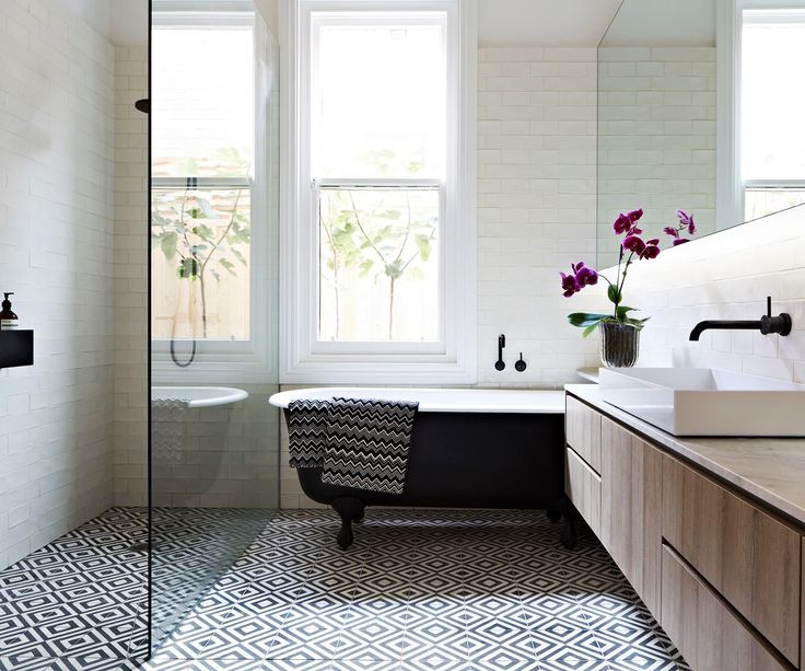 Diamonds are a Melbourne familys best friend in this sophisticated bathroom stylishly underpinned by a graphic floor pattern.