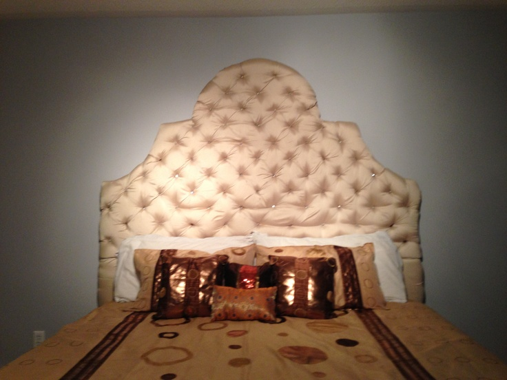 """DIY king size headboard 5ft tall .... Made with 2 x 1/2 inch ply board .. Raw silk material and 3"""" foam found at Walmart 2 bundle used 50$ each  .... We also used 81 Acrylic crystal stones bought from some Chinese website for 20$ total cost 200$"""
