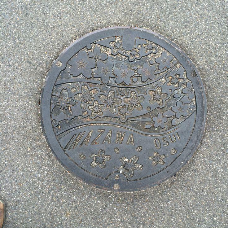 Cherry blossoms manhole cover. Place: Inazawa city, Aichi, Japan.