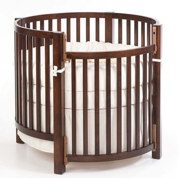 round crib! but in black or white maybe I love these they have the cutest canopies for them too!