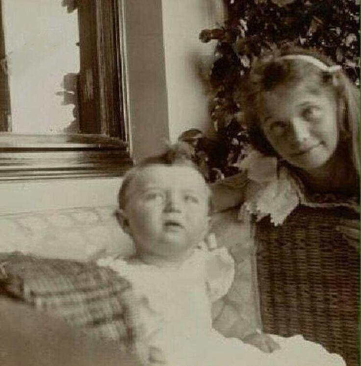 "Newly released photo of Tsarevich Alexei Nikolaevich Romanov of Russia and eldest sister,the Grand Duchess Olga Nikolaevna Romanova of Russia in 1905. ""AL"""