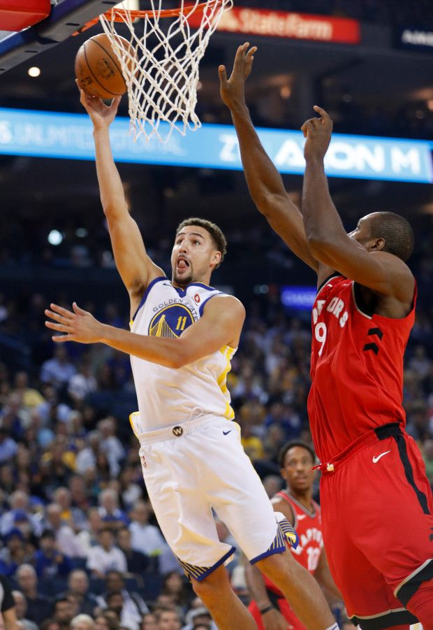 Golden State Warriors' Klay Thompson (11) takes a shot against Toronto Raptors' Serge Ibaka (9) in the first quarter at Oracle Arena in Oakland, Calif. on Wednesday, Oct. 25, 2017. (Nhat V. Meyer/Bay Area News Group)