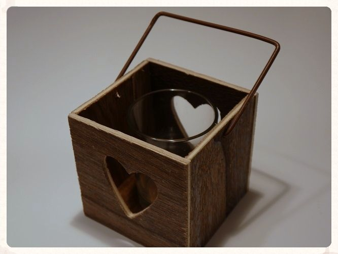 rustic wooden lantern T light holder with a handle and a round glass voile has heart cut-outs on two sides. This could be used as decoration at your wedding reception. Only £5.99. www.picketfenceweddings.co.uk