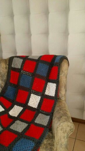 Red and denim crocheted granny square blanket