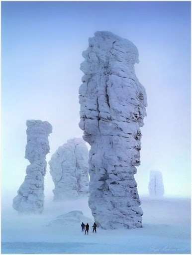 The Manpupuner rock formations (Man-Pupu-Nyer; Мань-Пупу-нёр) or the Seven Strong Men Rock Formations or Poles of the Komi Republic are a set of 7 gigantic abnormally shaped stone pillars located north of the Ural mountains in the Troitsko-Pechorsky District of the Komi Republic. These monoliths are around 30 to 42 m high and jut out of a hilly plateau formed through the weathering effects of ice and winds. Photo by Svetlana Pakhomova.Extreme cool!!