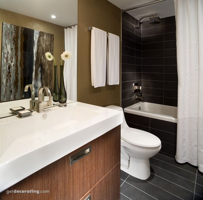 The colors of this modern bathroom are perfectly coordinated with the inspirational wall art.