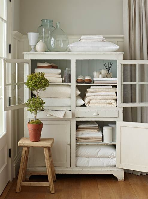 House does not have a linen closet? Turn a cabinet, hutch of wardrobe into one and place it close to the bedroom or bathroom.