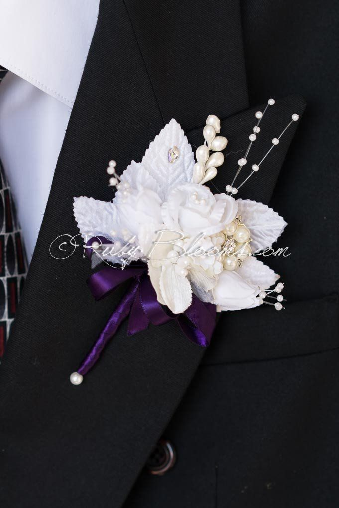 Crystal White Groom Buttonhole Stylish Crystal White Groom Buttonhole is the best choice as a wedding accessory and man etiquette.  #groom #boutonniere #crystalbroochpin #whiteandeggplant #silveraubergine #silkroses #wedding #bestman #prom #pearlbuttonhole #weddingaccessory #grooms #accessory #brideandgroom #lapel #buttonhole #pearlboutonniere #whiteboutonniere #whimsical #prom #bestman