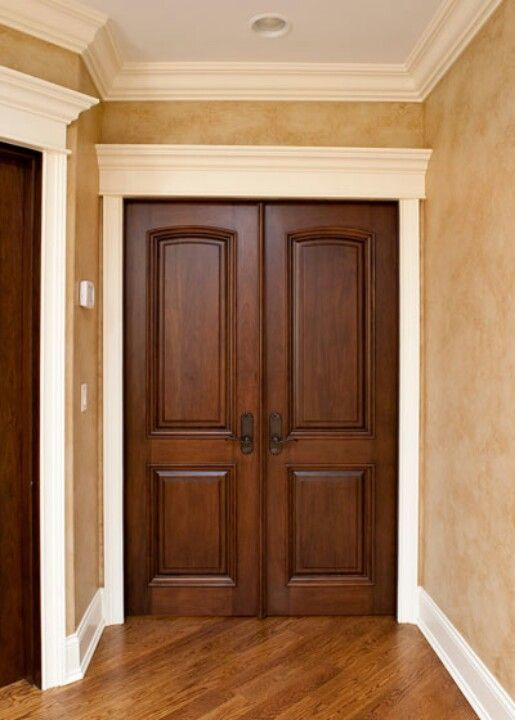 Wood doors with white trim. Ideas for our wood doors
