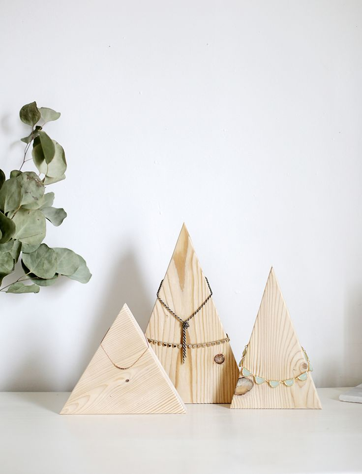 "turn a few wooden triangles into ""mountains"" to hang your necklaces and bracelets on."