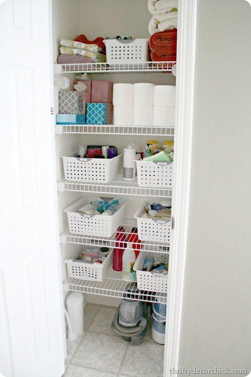 An organized linen closet in the powder room #organization