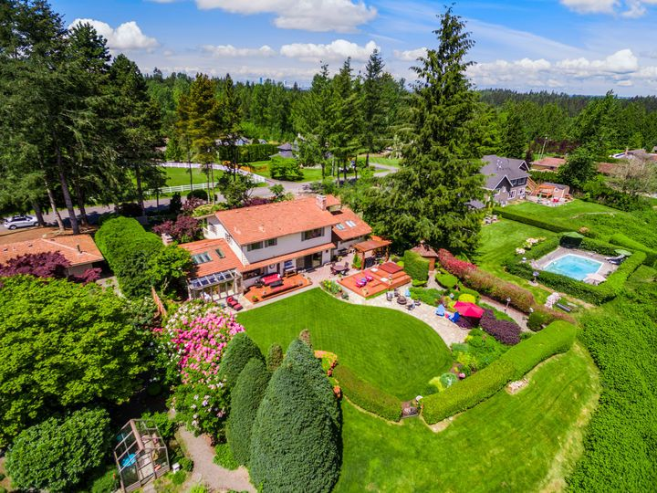 SNOHOMISH VIEW HOME: [ENTERTAINERS DREAM WITH A VIEW] A perfect mix of REFINED LIVING SPACES and OUTDOOR BLISS create the ultimate GATHERING place. Commanding VIEWS of the Valley & Cascades are the backdrop for this artfully renovated home. Epicurean Kitchen with upscale appliances and attached Butlers pantry with built in ice maker, Dining Room with solarium windows. Family Room graced with Rustic Stone floors & Wood planked ceiling opening to the outdoor wonder. AMAZING LODGE STYLE Bonus…