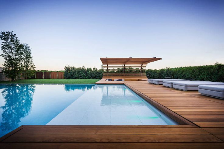 Private Pool With a Wooden Curved Terrace – Fubiz Media