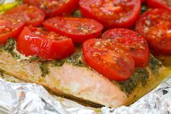 My go-to dinner recipe: Foil-baked salmon with basil pesto and tomatoes [I sometimes substitute bruschetta topping for the tomato slices]