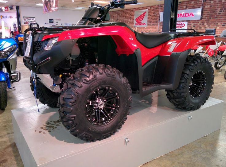 """Have you seen our 2014 Honda FourTrax Rancher? This four-wheeler comes in seven versions and it is sure to fit anyone's budget! A sleek new squared off look is a breath of fresh air to the machine. The bright """"Honda Red"""" coloring stands out as a symbol forever recognized by Honda owners and admirers. Fun for every occasion - that's the Honda way!"""