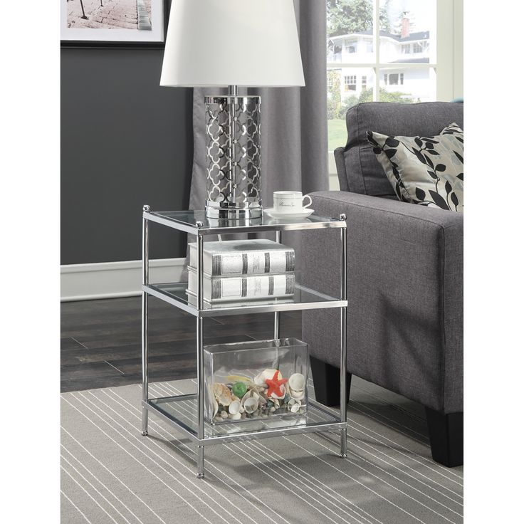 Enhance your living room decor with the Royal Crest end table by Convenience Concepts. The chrome frame provides the durability you need, while giving the contemporary look you want. Featuring three-t