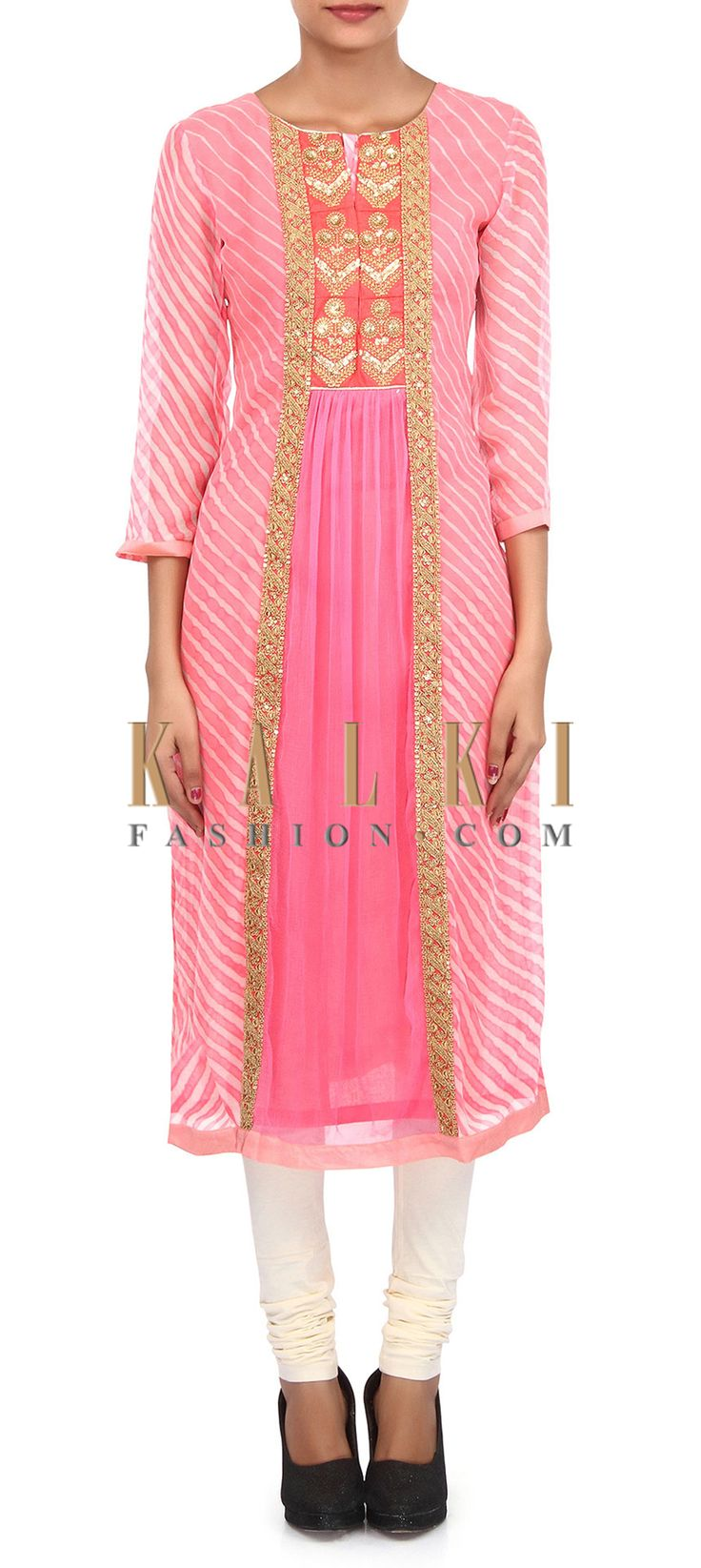 Buy Online from the link below. We ship worldwide (Free Shipping over US$100). Product SKU - 305750.Product Link - http://www.kalkifashion.com/peach-and-cream-suit-adorn-in-zari-and-gathers-embroidery-only-on-kalki.html