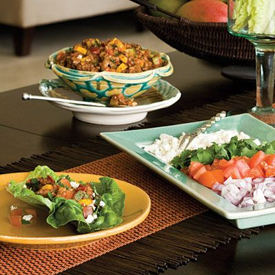 """Lean Green Lettuce Tacos """"Help yourself to Lean Green Lettuce Tacos, whose colorful ingredients offer big benefits. Romaine lettuce leaves arranged in a stemmed vase double as nutritious taco wraps and a decorative centerpiece."""""""
