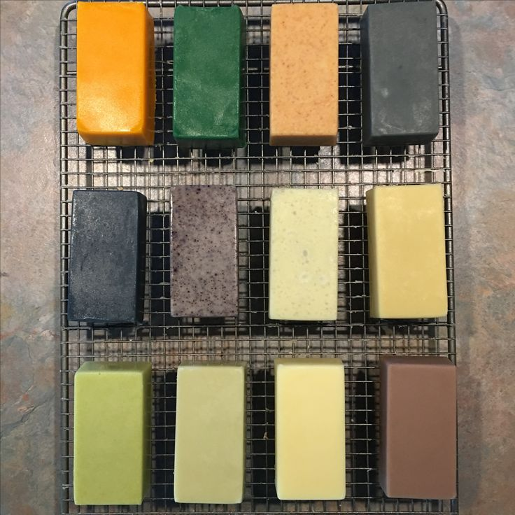 Natural soap colourants - botanicals and clays. Experimenting with natural colours. Left to right: Annatto, chlorophyll, turmeric, activated charcoal, indigo, alkanet, bentonite clay, yellow clay, barley grass, green clay, white clay, Brazilian purple clay.  Soap base is olive oil, coconut oil, organic cocoa butter, castor and shea butter.  Scented with rosemary EO.