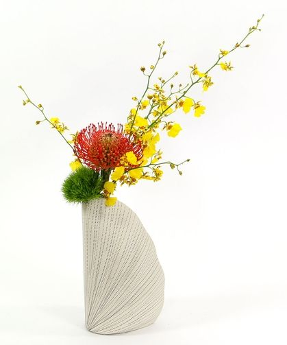 By The Sea | oncidium orchids, pin cushion protea, moss green carnation in a cool conch vase