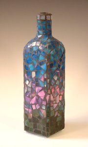 Mosaic bottle...how fun to make a set with bottoms cut off to put candles in