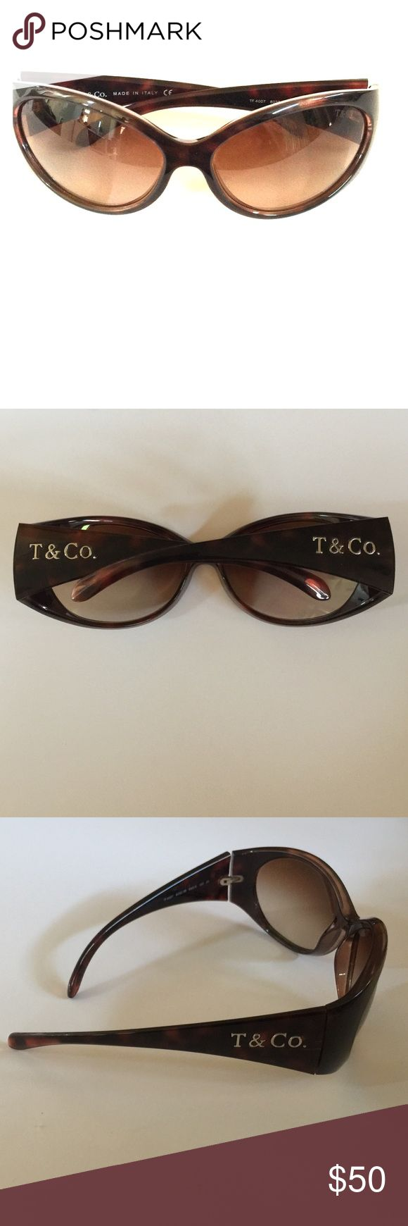 Tiffany and Co brown colored designer sunglasses Tiffany and Co brown tortoise colored designer sunglasses for sale. Only work a few times, no scratches. Accessories Sunglasses