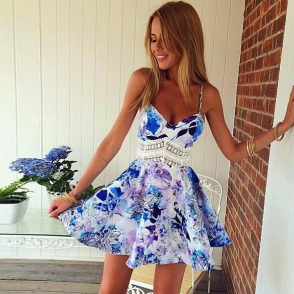Beautiful backless floral summer mini beach dress for the trendy woman Beautiful design offers a cute stylish look Perfect for the beach or pool Made from high