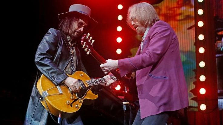 Mike Campbell, left, and Tom Petty of Tom Petty & the Heartbreakers performs at Wells Fargo Center i