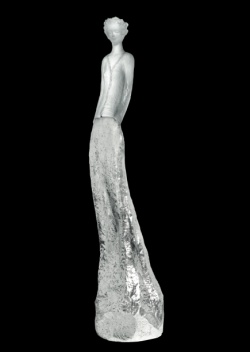 """For Daum, Jean-Philippe Richard has created his sixth sculpture with Charlotte in white and silver. delicately associating silvered bronze and white pate de cristal. Charlotte enchants us with her graceful silhouette and purity. """"Pate de cristal transcends the shape, contributing an air of mystery...and thus, bringing the imaginary into play."""" Charlotte is white and silver is limited to 75 pieces."""