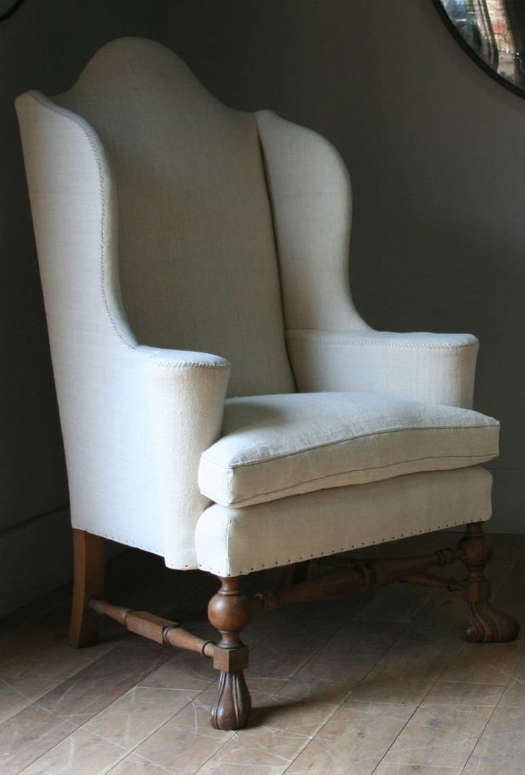 Set of armchairs and rocking chairs just out from beneath the shelter - A Huge Pair Of William Mary Style Wing Armchairs Covered In Heavy Antique Linen