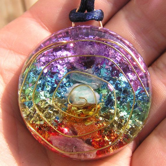7 Chakras Orgone Crystal Healing Pendant with Vintage Colored Flakes. $24.99, via Etsy.