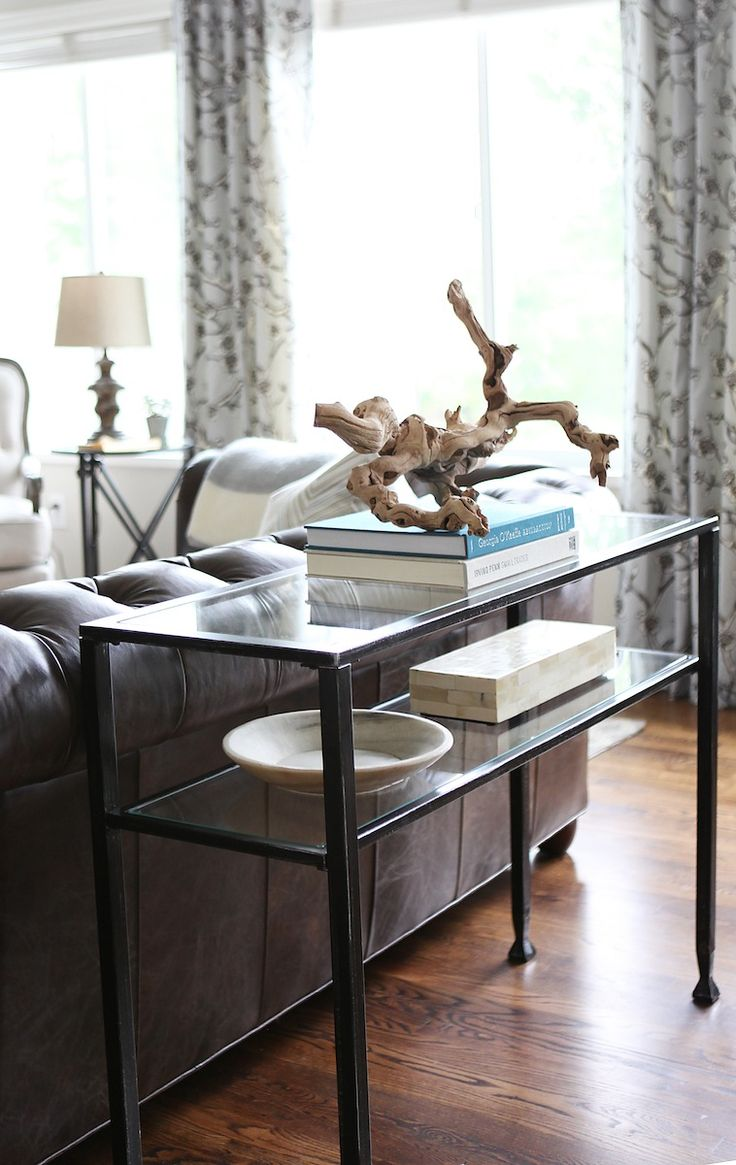 Sofa table decor pottery barn - Jana Bek Design Living Room With Pottery Barn Iron Glass Top Tanner Console Table Topped With A Manzanita Branch And Books