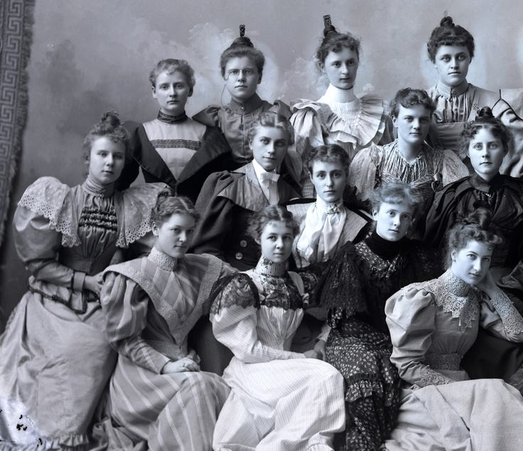 """Image #S09502 We begin in 1894 with the ladies of Delta Gamma. Although L. Frank Baum's book """"The Wonderful Wizard of Oz"""" has not yet been published (1900), the Gamma girls' hairstyles anticipate the look of the Tin Man. Meanwhile, their enlarged sleeves provide ample hiding spaces for chocolates and other goodies. For more information, please visit the UW-Madison Archives website at http://uwdc.library.wisc.edu/collections/UW/UWMadison"""