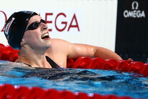 Katie Ledecky of the USA celebrates as she sets a new World Record time of 15:36.53 during the Swimming Women's 1500m Freestyle Final on day eleven of the 15th FINA World Championships at Palau Sant Jordi on July 30, 2013 in Barcelona, Spain.